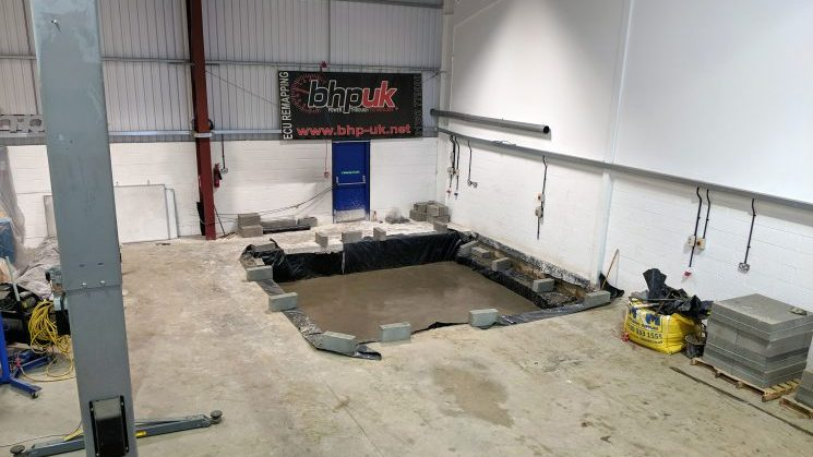 Our ECU remapping gets an upgrade with the latest in dyno technology. ENGINE TUNING latest news  Image of excavation in the workshop for the new dyno.